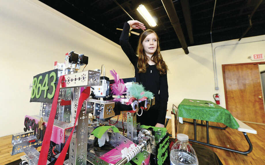 Hour photo / Erik Trautmann Blythe Serrano shows off her team's robot as the Fairfield County Makers' Guild celebrates their one-year anniversary with a open house Saturday.