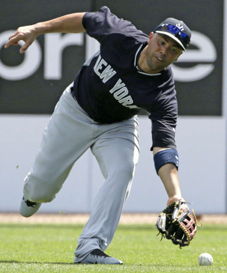 New York Yankees right fielder Carlos Beltran misjudges Toronto Blue Jay's Dayan Viciedo's fly ball during the fourth inning of a spring training baseball game in Dunedin, Fla., Saturday, March 14, 2015. (AP Photo/Kathy Willens)