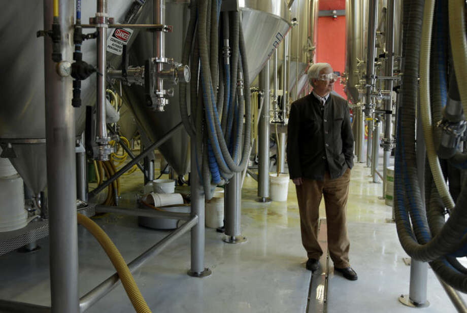 Tom Schlafly, co-founder of the brewery which produces the Schlafly brand of beers, poses for a photo inside Schlafly Bottleworks on Wednesday, March 12, 2014, in Maplewood, Mo. Schlafly has been in a trademark dispute with his aunt, conservative activist Phyllis Schlafly, over whether Schlafly is primarily a last name or a commercial brand that deserves legal protection. (AP Photo/Jeff Roberson)