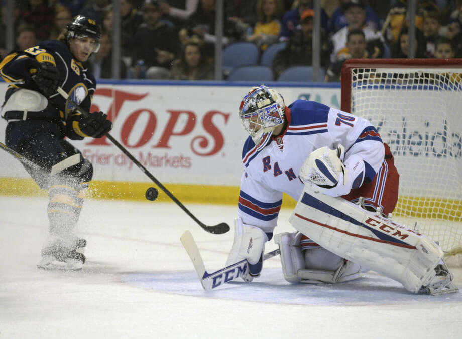 Buffalo Sabres center Tyler Ennis (63) watches his breakaway shot get stopped by New York Rangers goaltender Mackenzie Skapski (70) during the first period of an NHL hockey game Saturday, Mar. 14, 2015, in Buffalo, N.Y. (AP Photo/Gary Wiepert)