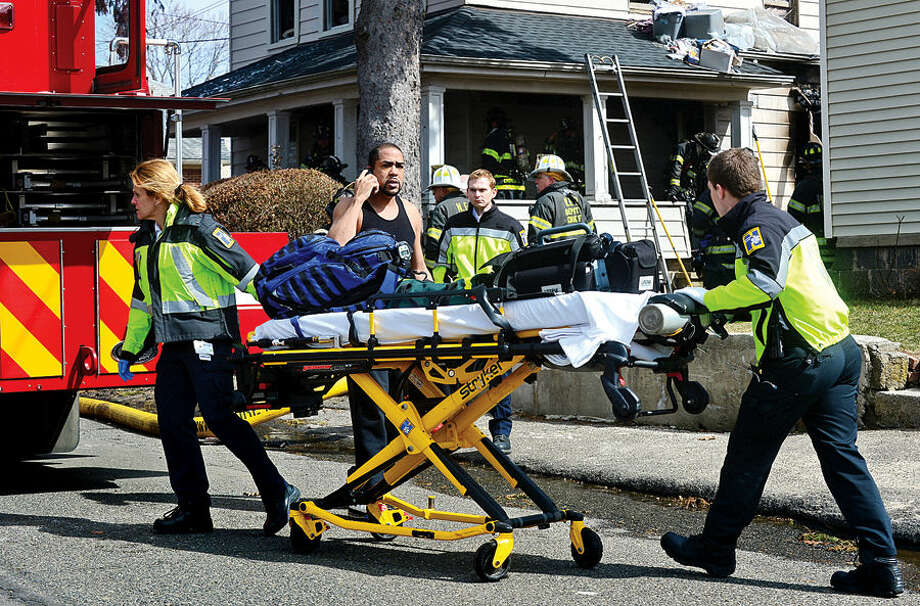 Hour photo / Erik Trautmann Emergency personnel respond to 201 Ely Avenue where a fire broke out Wednesday morning sending one victim to the hospital.