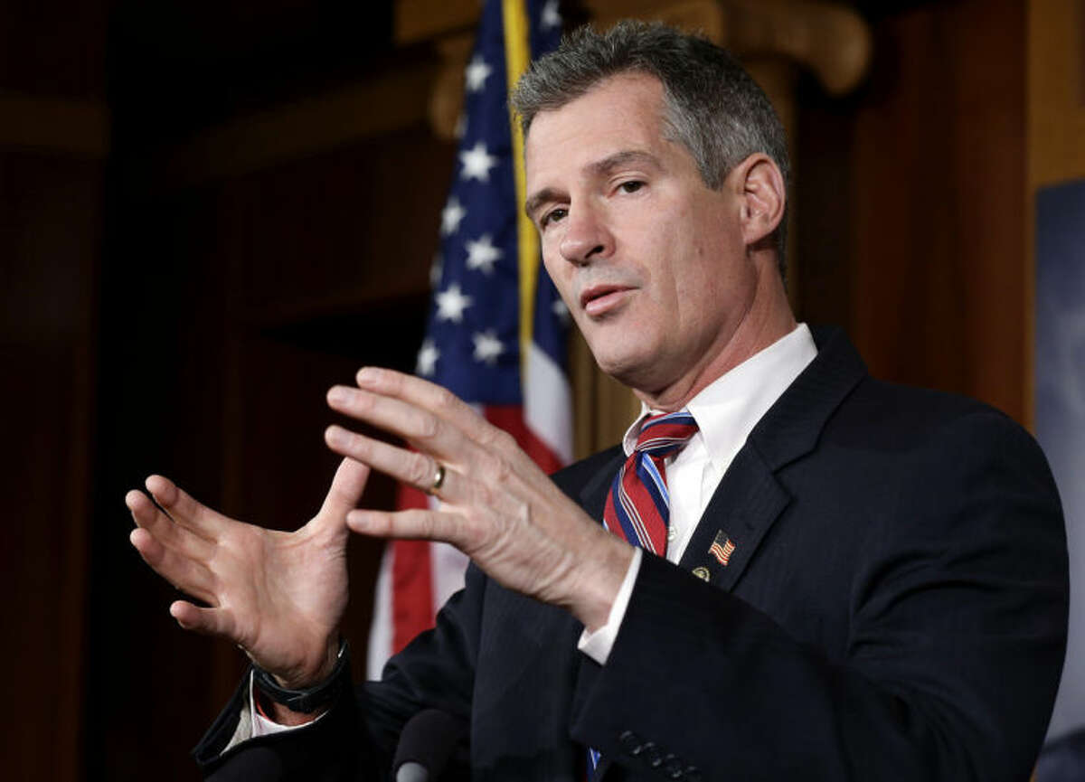 FILE - In this Nov. 13, 2012 file photo, then-Massachusetts Sen. Scott Brown speaks on Capitol Hill in Washington. Brown has begun seeking campaign staff while courting New Hampshire?'s political elite. The moves represent what local Republicans consider Brown?'s first serious steps toward launching a Senate campaign against Democratic Sen. Jeanne Shaheen. The stakes are high for the GOP?'s push for the Senate majority this fall and Brown?'s own political ambitions. (AP Photo/Alex Brandon, File)