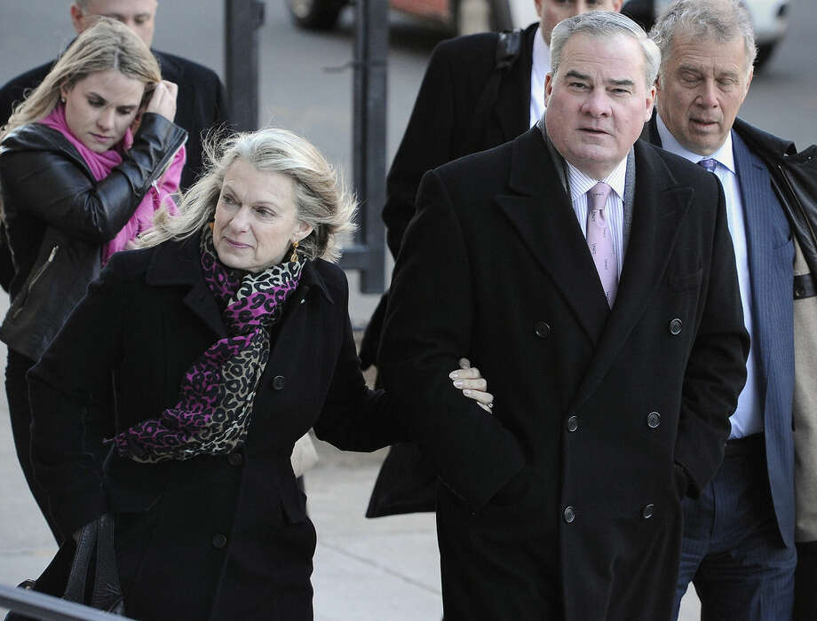 Former Connecticut Gov. John Rowland and his wife Patty arrive at federal court in New Haven, Wednesday, March 18, 2015. A federal court jury convicted Rowland in September of federal charges that he conspired to hide payment for work on two congressional campaigns. His sentencing on Wednesday will come 10 years to the day that he was sentenced to a year and a day in prison for accepting illegal gifts while in office, including trips and improvements to his lakeside cottage. (AP Photo/Jessica Hill)