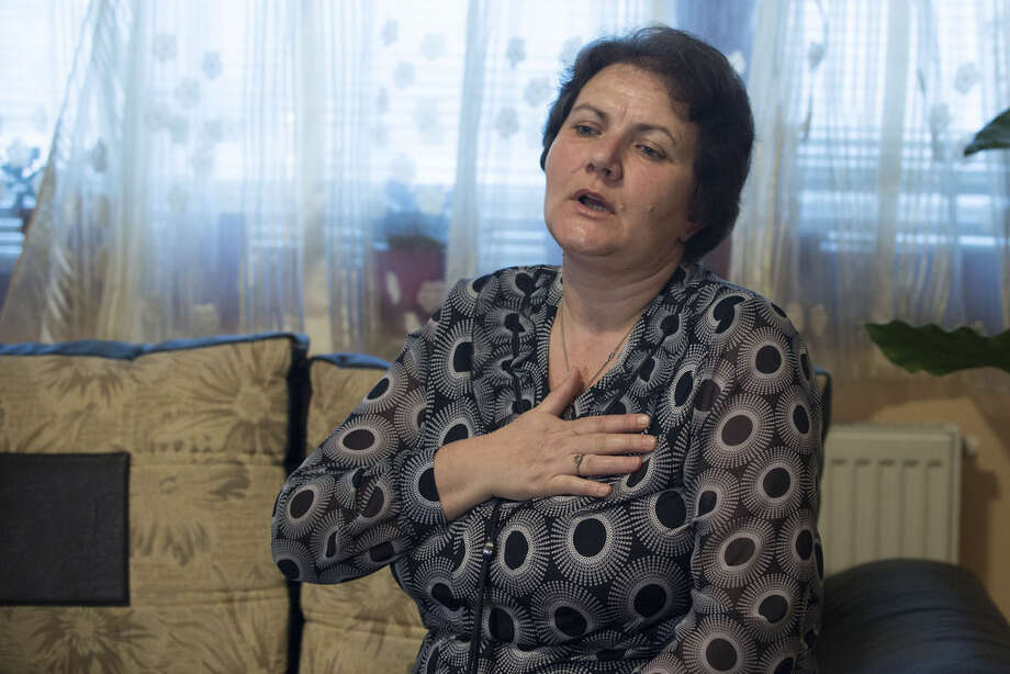 "In this photo taken on Friday March 6, 2015 in Sarajevo, Bosnia, Muslim Bosniak woman Suhra Sinanovic reacts as she talks about her husband Muriz Sinanovic who had been killed in July 1995 Srebrenica massacre. Serbia arrested men accused of executing over 1,000 Muslims at the warehouse on the outskirts of Srebrenica, The Associated Press has learned in Serbia's first arrests of men who carried out mass executions around the town. Serbia has put on trial men who took a group of prisoners away from Srebrenica to be killed, and in 2011 it arrested Ratko Mladic ""the warlord who masterminded the slaughter "" and sent him to The Hague, Netherlands to face an international criminal court. Arrests were Serbia's first attempt to bring to justice men who got their hands bloody in the killing machine known as the Srebrenica massacre 20 years ago this July. (AP Photo/Sulejman Omerbasic)"