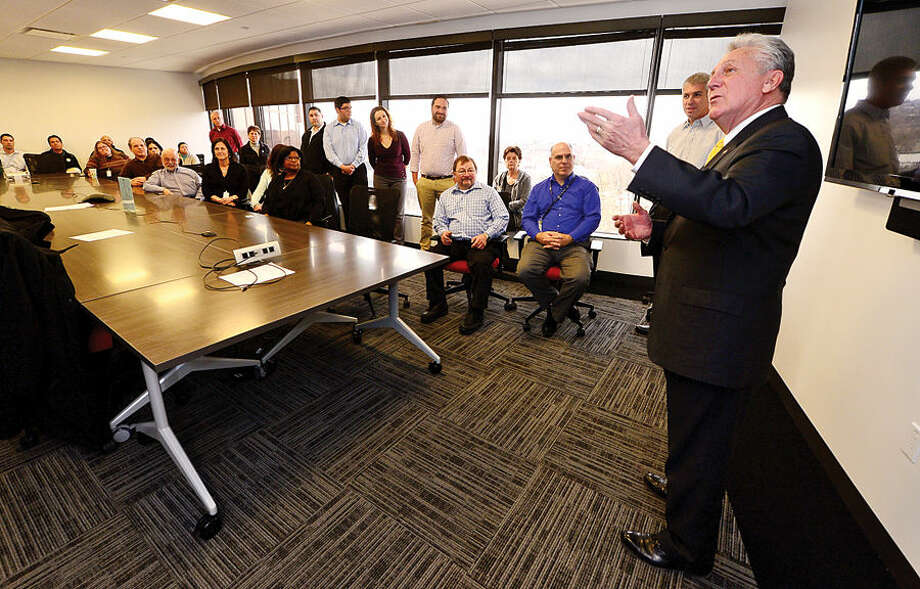 Hour photo / Erik Trautmann Mayor Harry Rilling welcomes CEO David Rothstein and his company, RTI, to Norwalk during a tour of their facilities at Merritt View Wednesday.