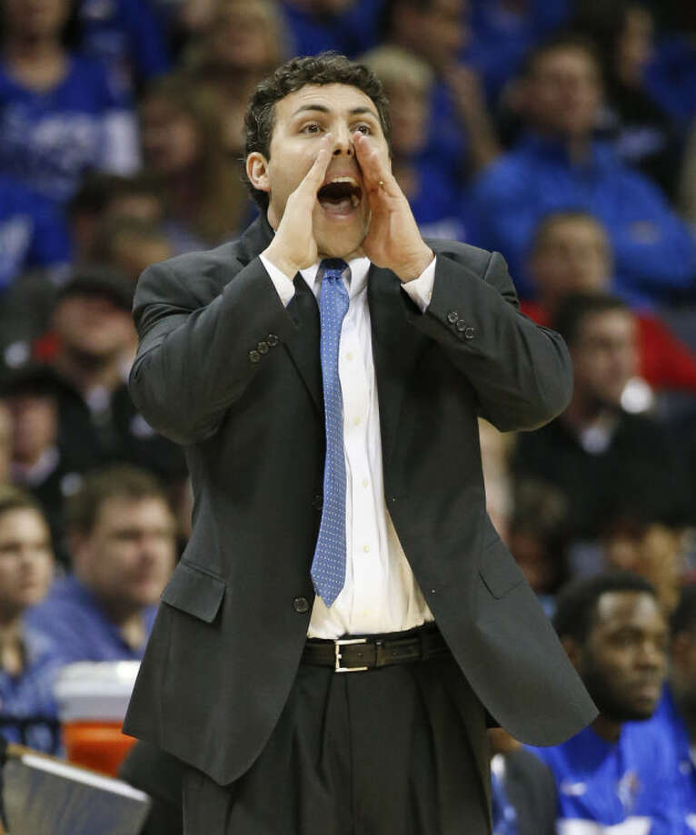 Memphis coach Josh Pastner yells to his players during the first half of an NCAA college basketball game against Connecticut in the quarterfinals of the American Athletic Conference tournament Thursday, March 13, 2014, in Memphis, Tenn. (AP Photo/Mark Humphrey)