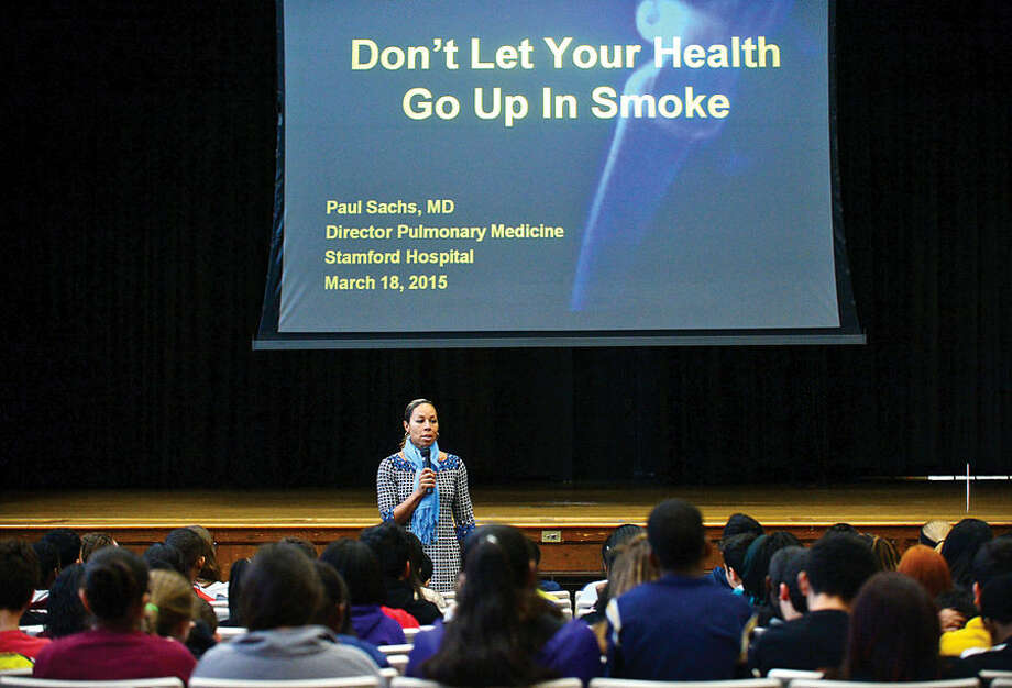 Hour photo / Erik Trautmann Principal Charmaine Tourse talks to 8th grade students as the School Based Health Center (SBHC) at Dolan Middle School helps teach students about the dangers of tobacco with a special assembly to commemorate National Kick Butts Day featuring Stamford Hospital Pulmonologist Paul Sachs, M.D.