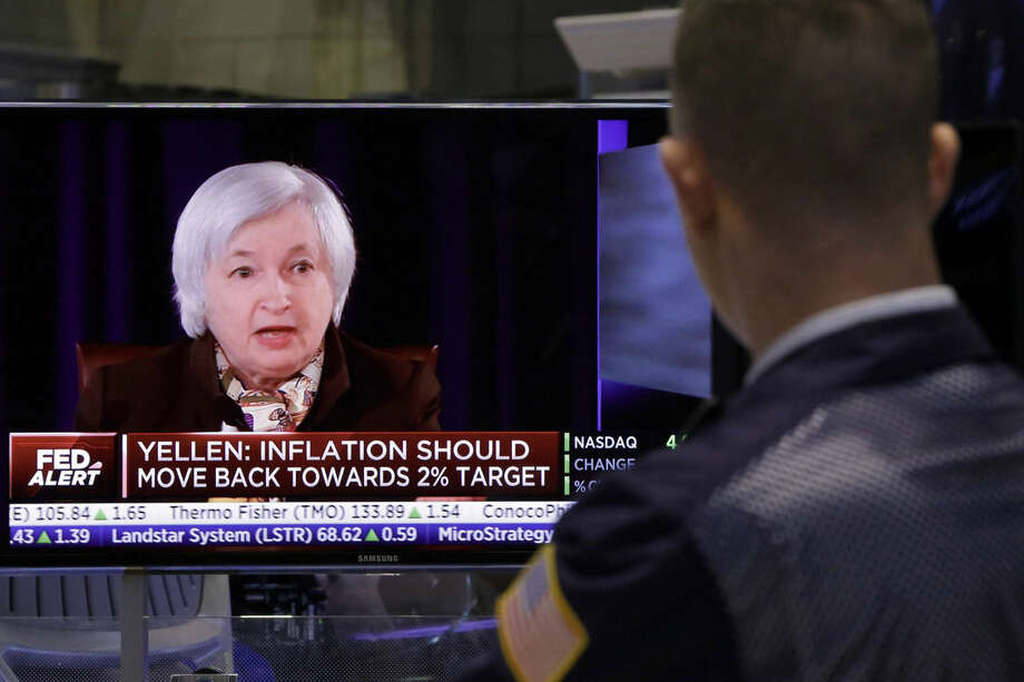 "A trader on the floor of the New York Stock Exchange watches Federal reserve Chair Janet Yellen's news conference, Wednesday, March 18, 2015. The Federal Reserve is signaling that it's edging closer to raising interest rates from record lows in light of a strengthening job market. The Fed no longer says it will be ""patient"" in starting to raise its benchmark rate. (AP Photo/Richard Drew)"