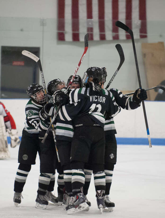 JOSH GIBNEY PHOTO Connecticut players celebrate a goal by A.J. Peckich during the first period of Wednesday's EHL championship final series game at Cyclones Arena in Hudson, N.H..
