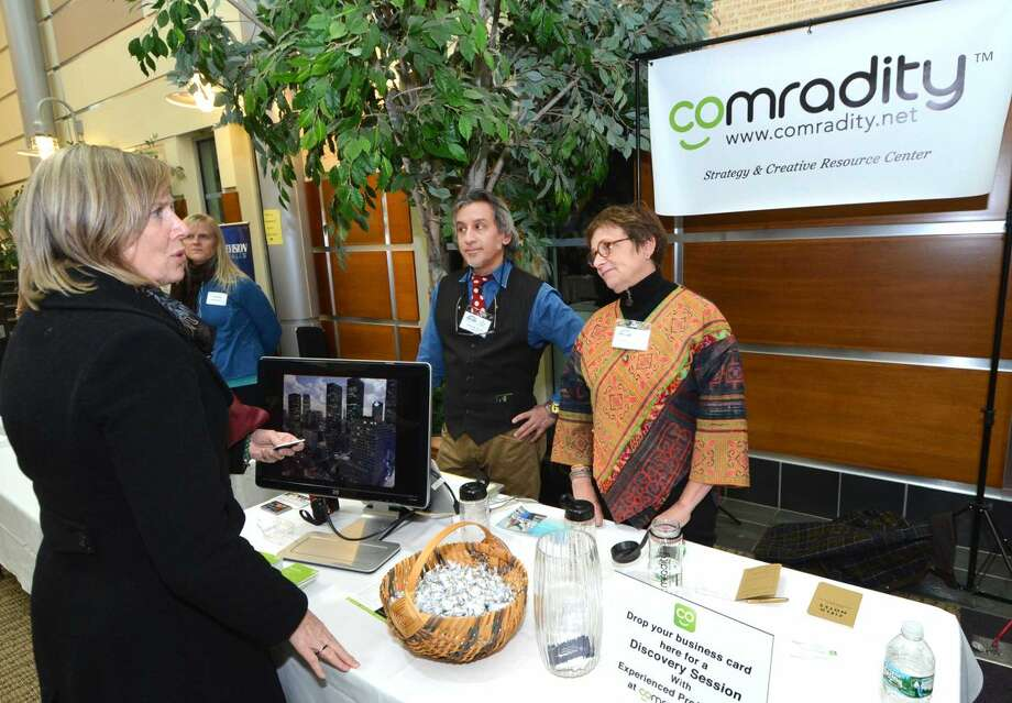 Hour Photo/Alex von Kleydorff Comradity, Strategy and Resource Center personnel talks with visitors at the 2015 Multi Chamber Expo and Networking Event at NCC