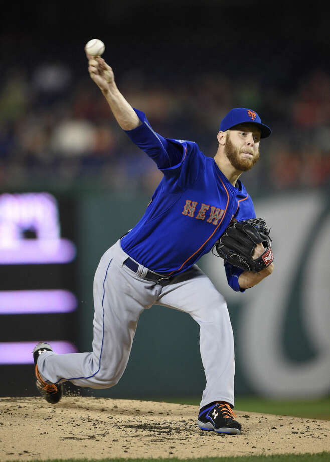 FILE - In this Sept. 25, 2014, file photo, New York Mets starting pitcher Zack Wheeler delivers against the Washington Nationals during the first inning of the second baseball game of a doubleheader in Washington. Mets right-hander Zack Wheeler has a torn elbow ligament, a blow to a team hoping to compete for a playoff berth following Matt Harvey's return from Tommy John surgery. If Wheeler needs elbow ligament-replacement surgery, he likely would be out until early during the 2016 season. The Mets said Wheeler had an MRI exam Saturday, March 15, 2015, in Port St. Lucie, Fla. (AP Photo/Nick Wass, File)