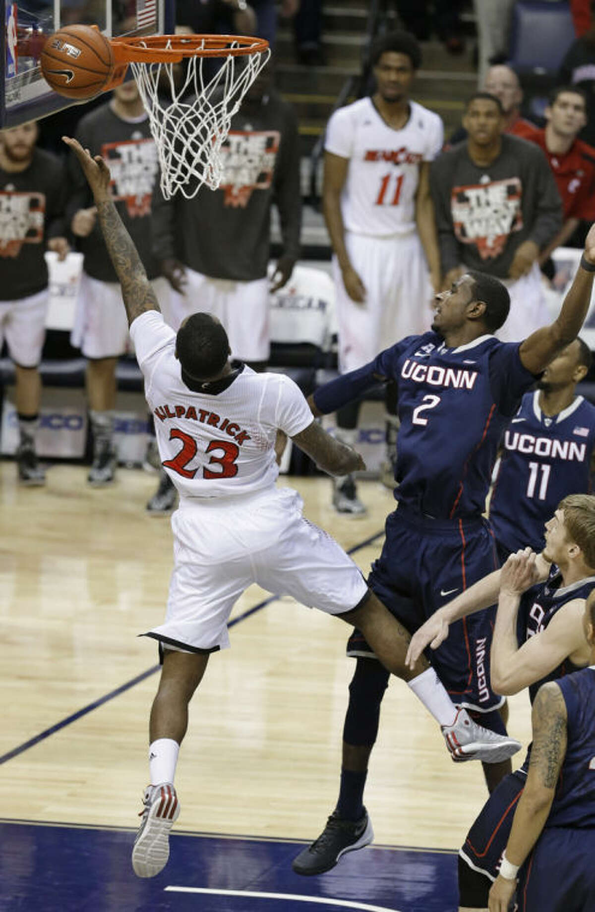 Cincinnati guard Sean Kilpatrick (23) misses a layup as Connecticut forward DeAndre Daniels (2) defends on the final shot of an NCAA college basketball game in the semifinals of the American Athletic Conference men's tournament Friday, March 14, 2014, in Memphis, Tenn. Connecticut won 58-56. (AP Photo/Mark Humphrey)