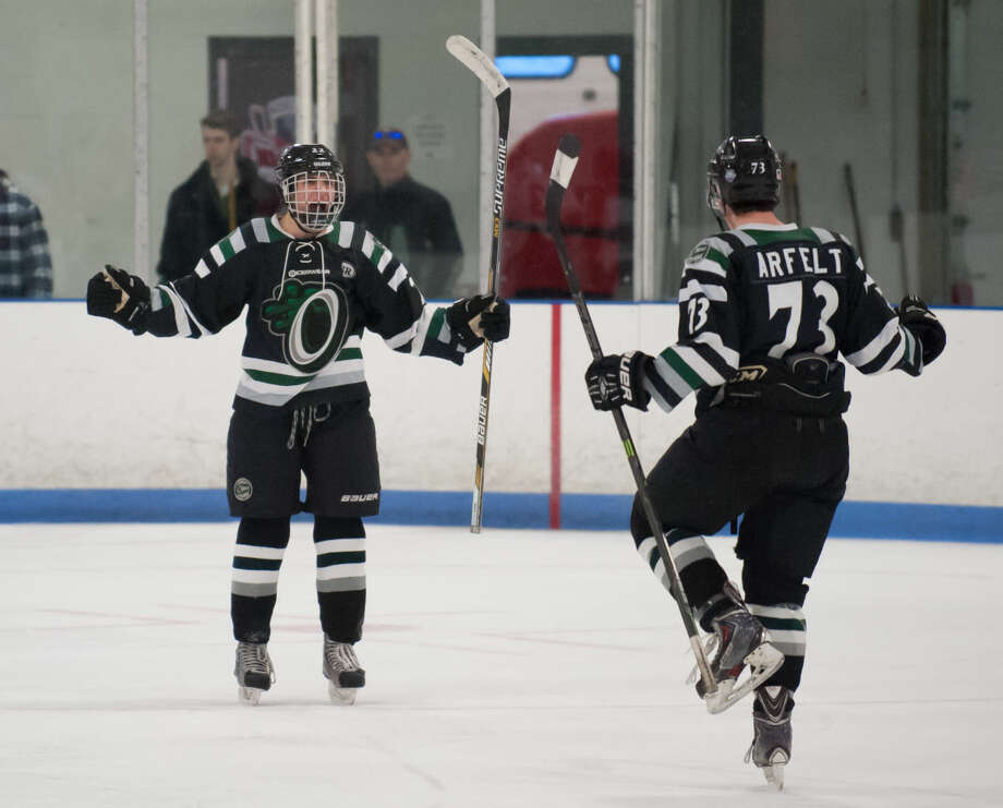 JOSH GIBNEY PHOTO Connecticut's Sebastian Foster, left, and Oscar Arfelt celebrate Foster's goal during the first period of Wednesday's EHL championship final series game at Cyclones Arena in Hudson, N.H..