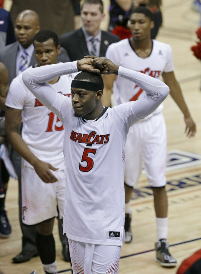 Cincinnati forward Justin Jackson (5) leaves the court after Cincinnati lost to Connecticut 58-56 in an NCAA college basketball game in the semifinals of the American Athletic Conference men's tournament Friday, March 14, 2014, in Memphis, Tenn. (AP Photo/Mark Humphrey)