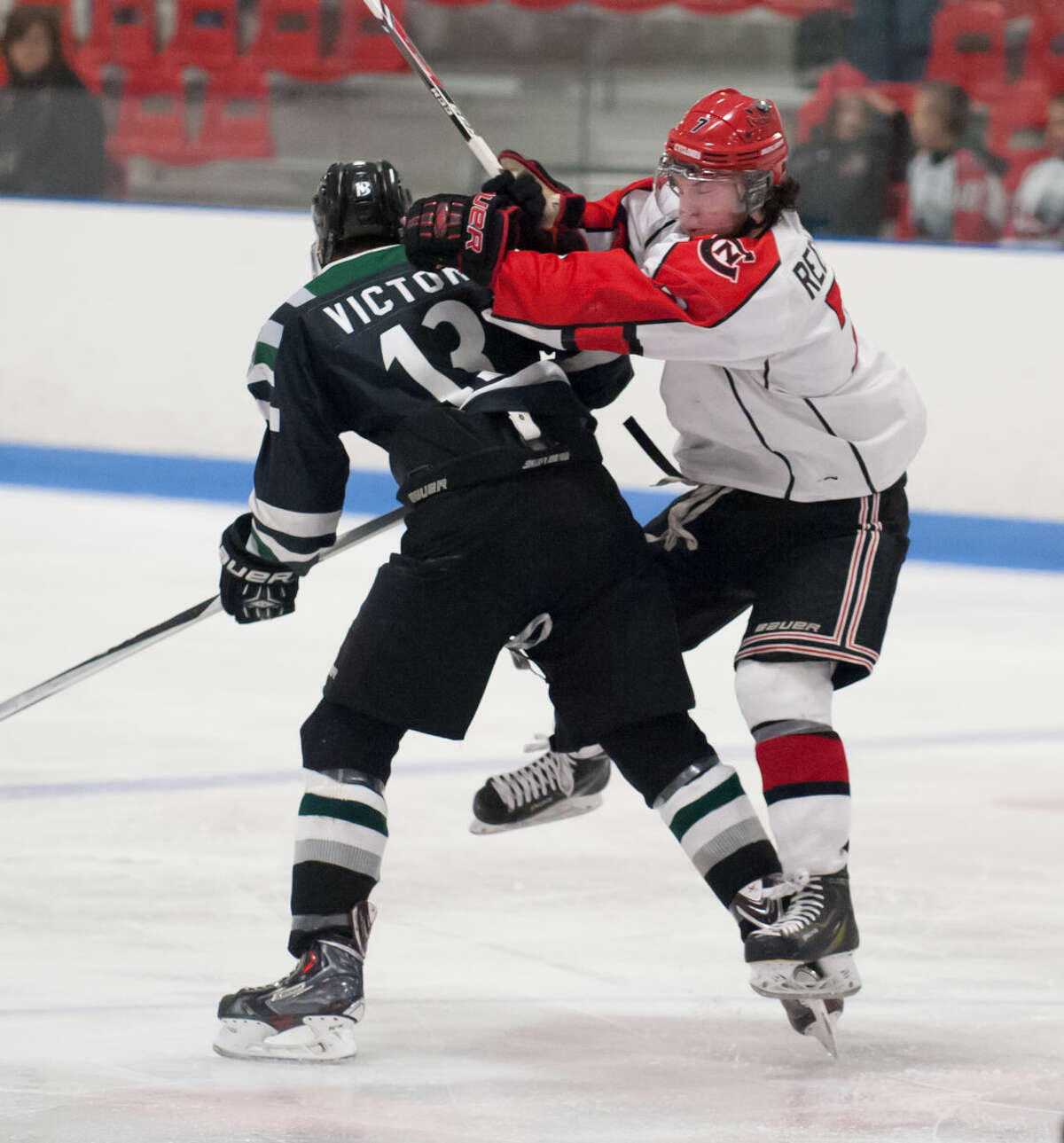 JOSH GIBNEY PHOTO Connecticut's Josh Victor, left, and Northern's Nolan Redler collide during the second period of Wednesday's EHL championship final series game at Cyclones Arena in Hudson, N.H..