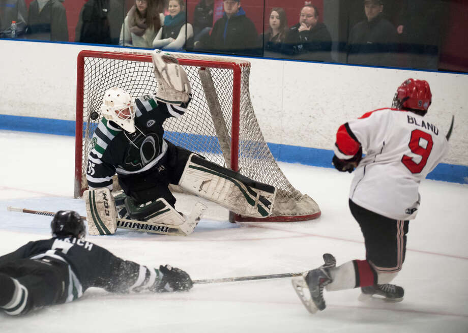 JOSH GIBNEY PHOTO Northern's Aaron Bland (9) beats Connecticut goaltender Chris Bastone for a goal during the third period of Wednesday's EHL championship final series game at Cyclones Arena in Hudson, N.H..