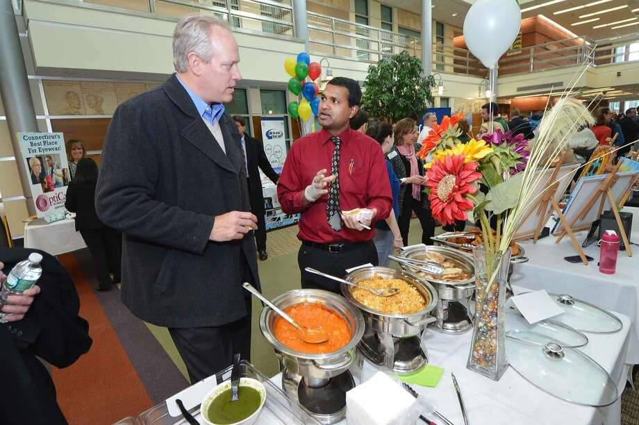 Hour Photo/Alex von Kleydorff At the 2015 Multi Chamber Expo and Networking event at NCC, The Mumbai Times serves some traditional Indian food