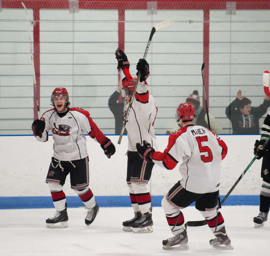 JOSH GIBNEY PHOTO Northern Cyclone players celebrate Nolan Redler's overtime game winning goal during Wednesday's EHL championship final series game against Connecticut at Cyclones Arena in Hudson, N.H..