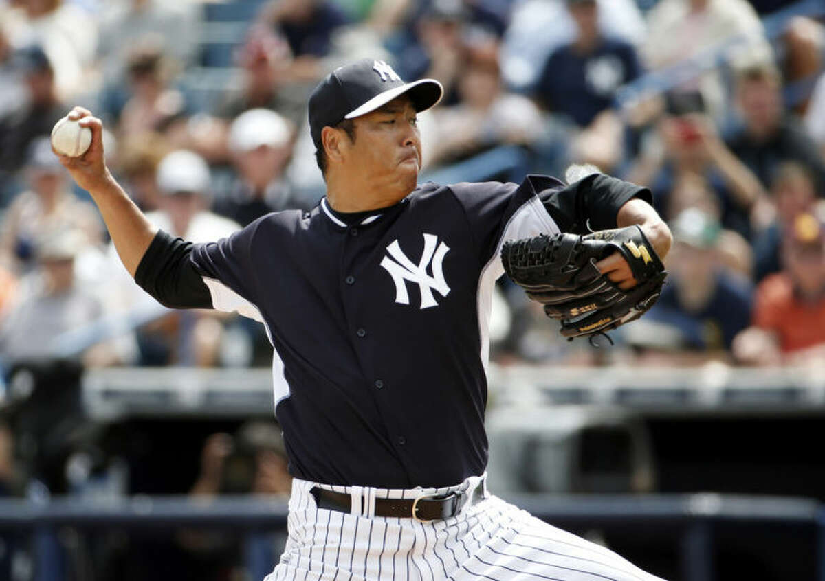 New York Yankees starting pitcher Hiroki Kuroda delivers in the first inning against the Detroit Tigers in a spring exhibition baseball game in Tampa, Fla., Wednesday, March 12, 2014. (AP Photo/Kathy Willens)