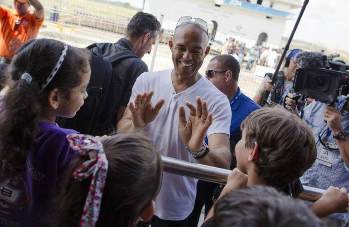 """Mariano Rivera former New York Yankees baseball great, talks to children during a visit to the Miraflores Locks at the Panama Canal in Panama City, Friday, March 14, 2014. The New York Yankees and the Miami Marlins will play on March 15-16, in the """"Legend Series"""" to honor the recently retired Rivera. (AP Photo/Tito Herrera)"""