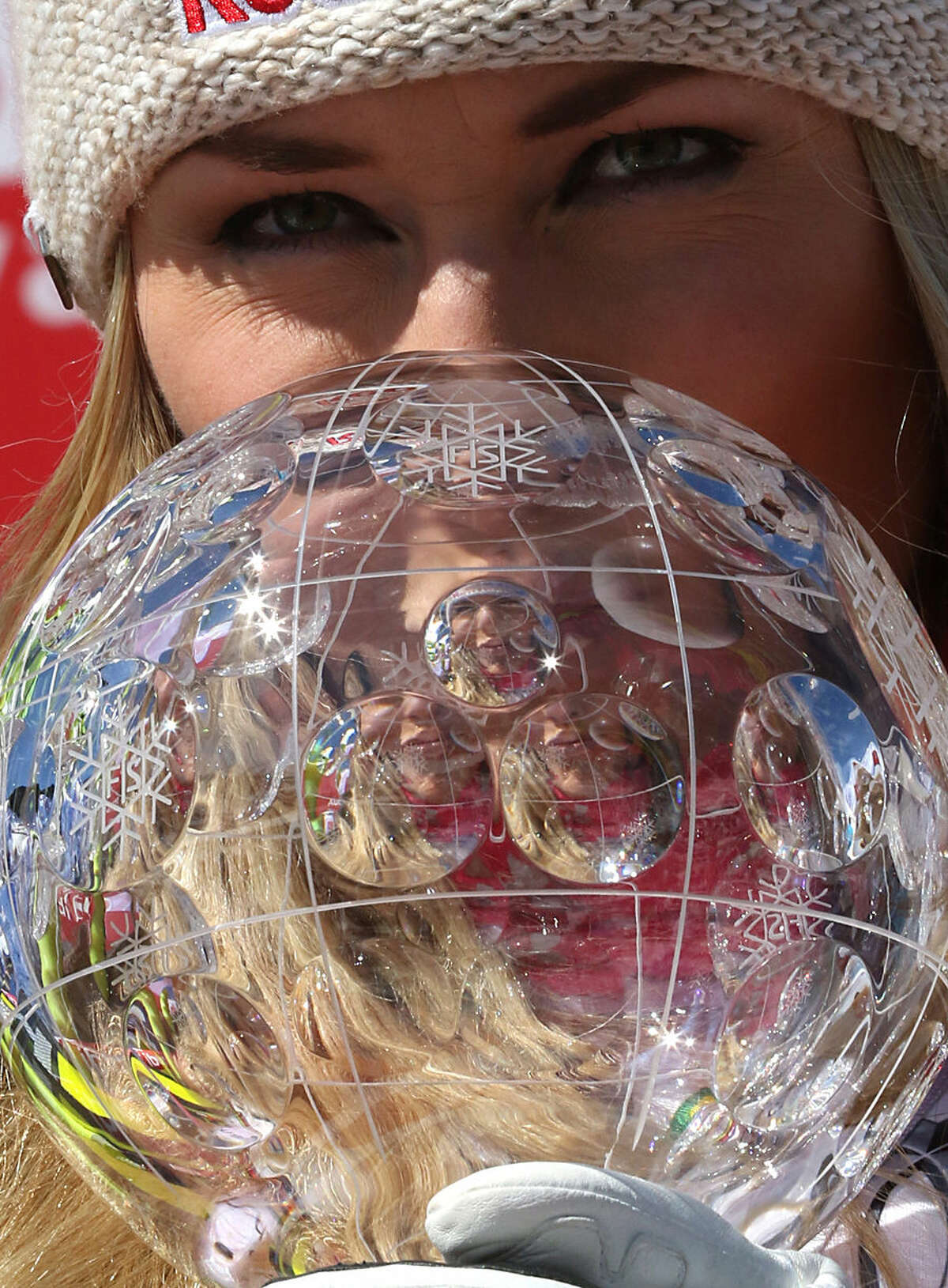 CORRECTS PHOTOGRAPHER'S NAME Lindsey Vonn, of the United States, kisses the alpine ski, women's World Cup downhill's discipline trophy, at the World Cup finals in Meribel, France, Wednesday, March 18, 2015. (AP Photo/Armando Trovati)