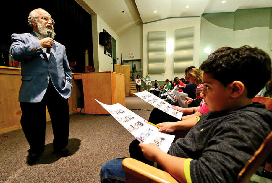 "Hour photo / Erik Trautmann George Albano, The Hour's Associate Sports Editor, speaks to 6th graders at West Rocks Middle School Friday about his ""Celebrating Black History Month Through Norwalk Sports"" series, which was published in The Hour during the month of February."