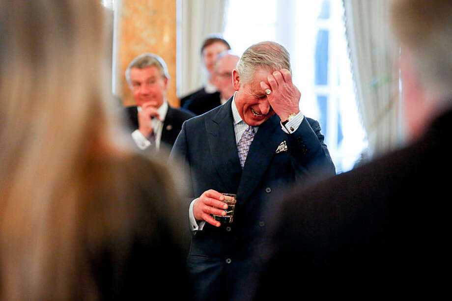 Britain's Prince Charles laughs as British Ambassador to the United States Sir Peter Westmacott gives welcoming remarks during a private reception at the British Ambassador's Residence on Wednesday, March 18, 2015 in Washington. (AP Photo/Andrew Harnik)