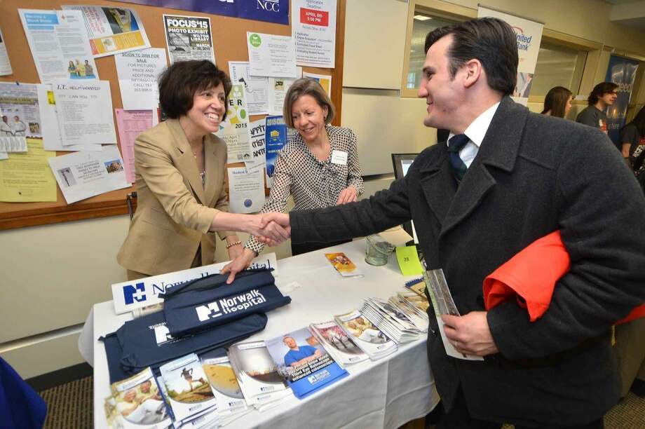 Hour Photo/Alex von Kleydorff Maura Romaine and Susan Arnold spread the good word about The Norwalk Hospital at the 2015 Multi Chamber Expo and Netwok Event