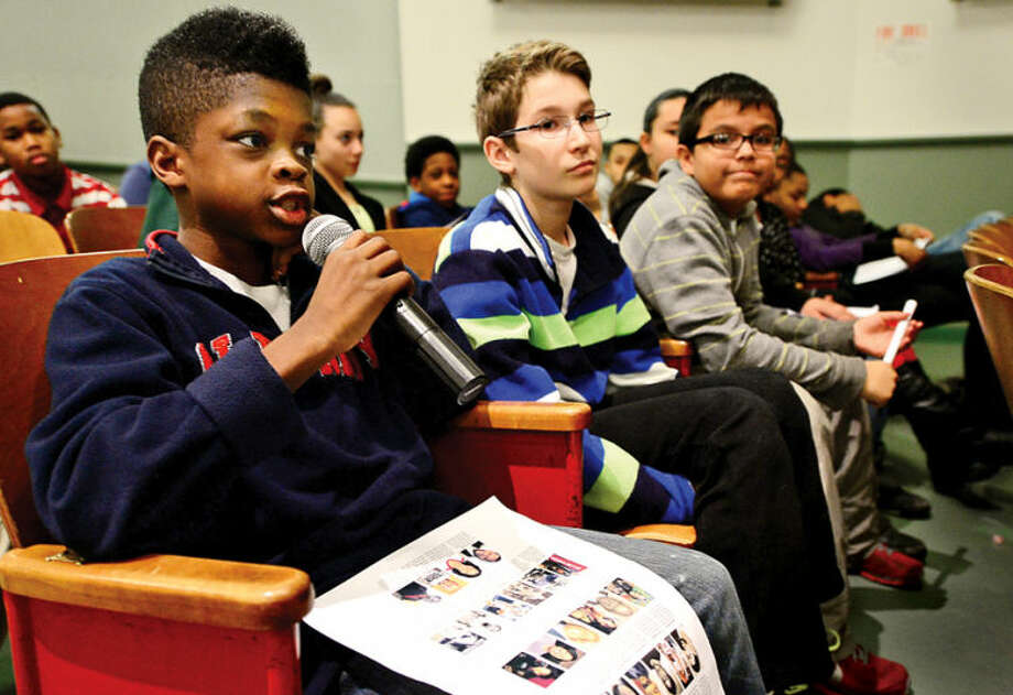 "Hour photo / Erik Trautmann West Rocks Middle School 6th graders Miles Russell askes a question of George Albano, The Hour's Associate Sports Editor, who spoke to 6th graders at the school Friday about his ""Celebrating Black History Month Through Norwalk Sports"" series, which was published in The Hour during the month of February."