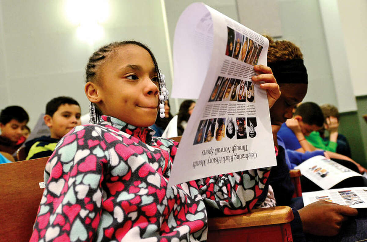 """Hour photo / Erik Trautmann 6th grader Iyanna Vernon listens to a presentation by George Albano, The Hour's Associate Sports Editor, as he speaks to 6th graders at West Rocks Middle School Friday about his """"Celebrating Black History Month Through Norwalk Sports"""" series, which was published in The Hour during the month of February."""