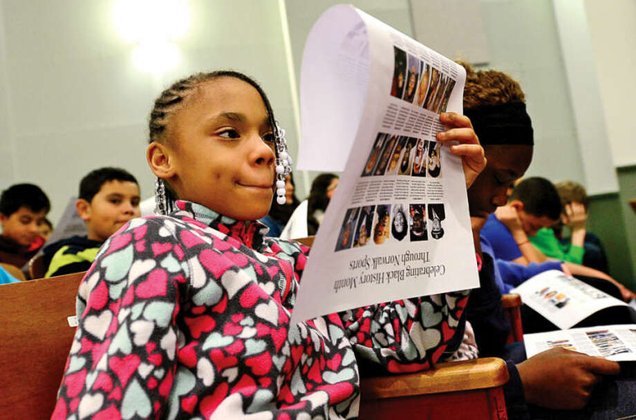 "Hour photo / Erik Trautmann 6th grader Iyanna Vernon listens to a presentation by George Albano, The Hour's Associate Sports Editor, as he speaks to 6th graders at West Rocks Middle School Friday about his ""Celebrating Black History Month Through Norwalk Sports"" series, which was published in The Hour during the month of February."