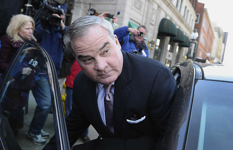 Former Connecticut Gov. John Rowland leaves federal court in New Haven, Wednesday, March 18, 2015. Rowland was sentenced to 30 months in prison for his role in a political consulting scheme on Wednesday, exactly one decade after he was ordered behind bars in an earlier scandal that forced him from office. (AP Photo/Jessica Hill)