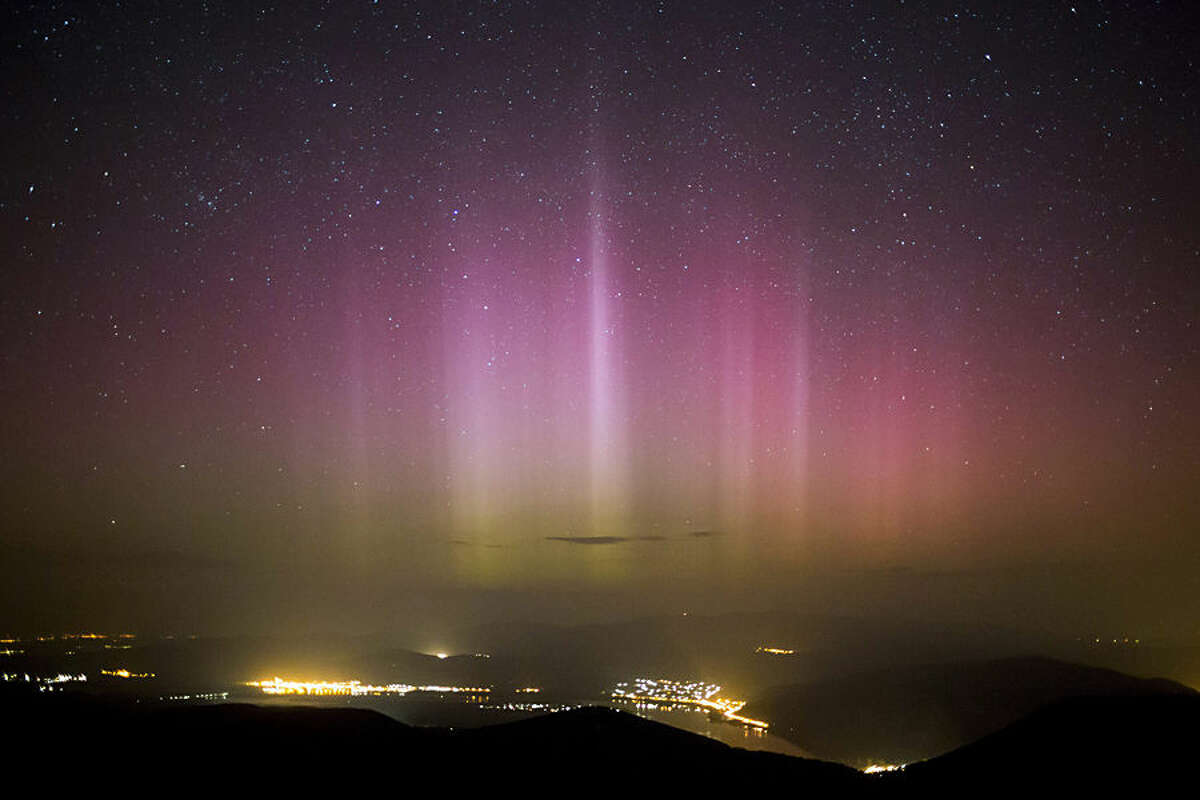 The Northern Lights (Aurora borealis) are seen on the sky above Pilisszentkereszt, 26 kms north of Budapest, Hungary, Wednesday morning, March 18, 2015. Photo was taken from the viewpoint of Dobogoko in Salgotarjan. (AP Photo/MTI,Balazs Mohai)