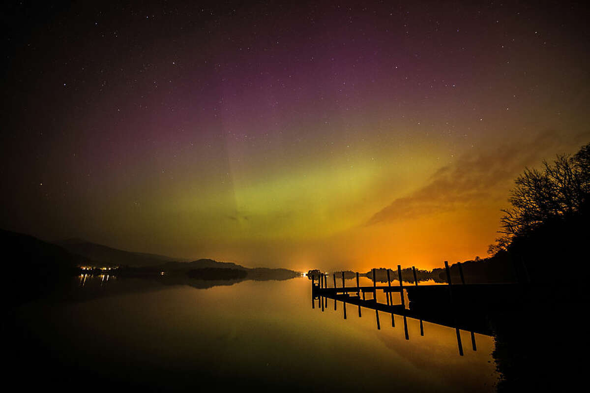 The aurora borealis, or the northern lights, over Derwent water near Keswick, England, Wednesday March 18, 2015. The northern lights are the result of collisions between gaseous particles in the Earth's atmosphere with charged particles released from the sun. (AP Photo/PA, Owen Humphreys) UNITED KINGDOM OUT NO SALES NO ARCHIVE