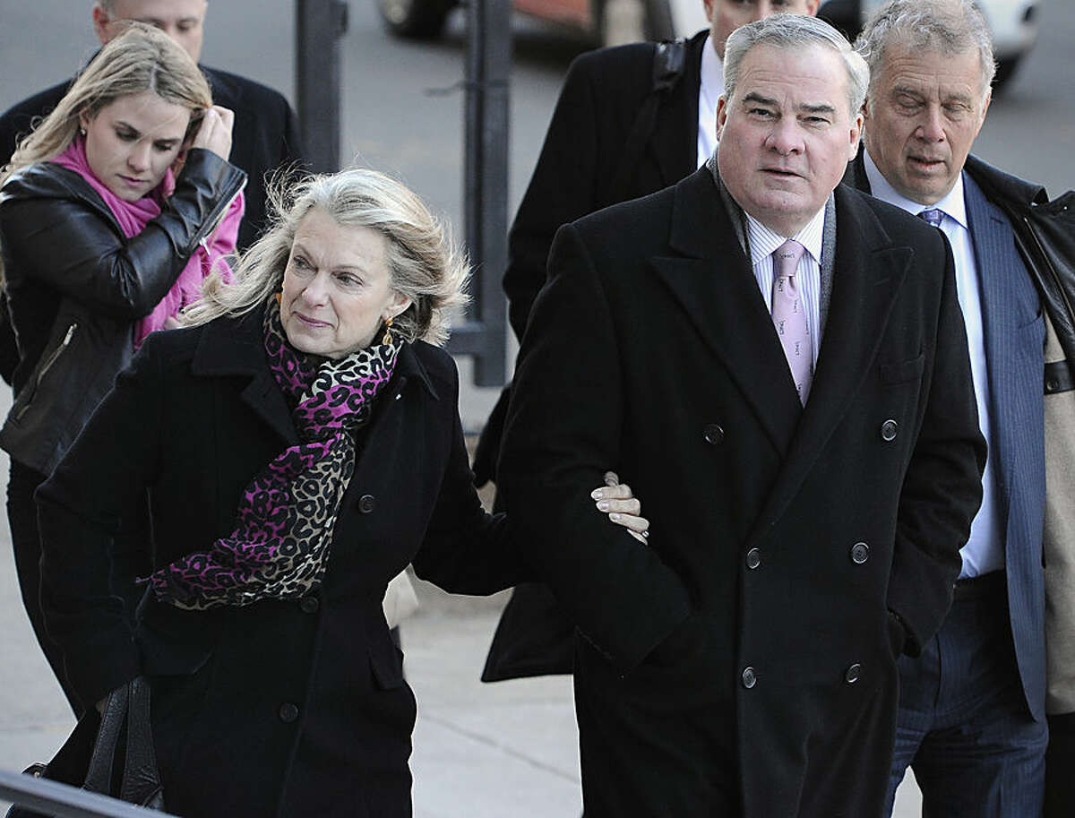 Former Connecticut Gov. John Rowland and his wife, Patty, arrive at federal court in New Haven, Conn., Wednesday, March 18, 2015. A court jury convicted Rowland in September of federal charges that he conspired to hide payment for work on two congressional campaigns. His sentencing on Wednesday will come 10 years to the day that he was sentenced to a year and a day in prison for accepting illegal gifts while in office, including trips and improvements to his lakeside cottage. (AP Photo/Jessica Hill)