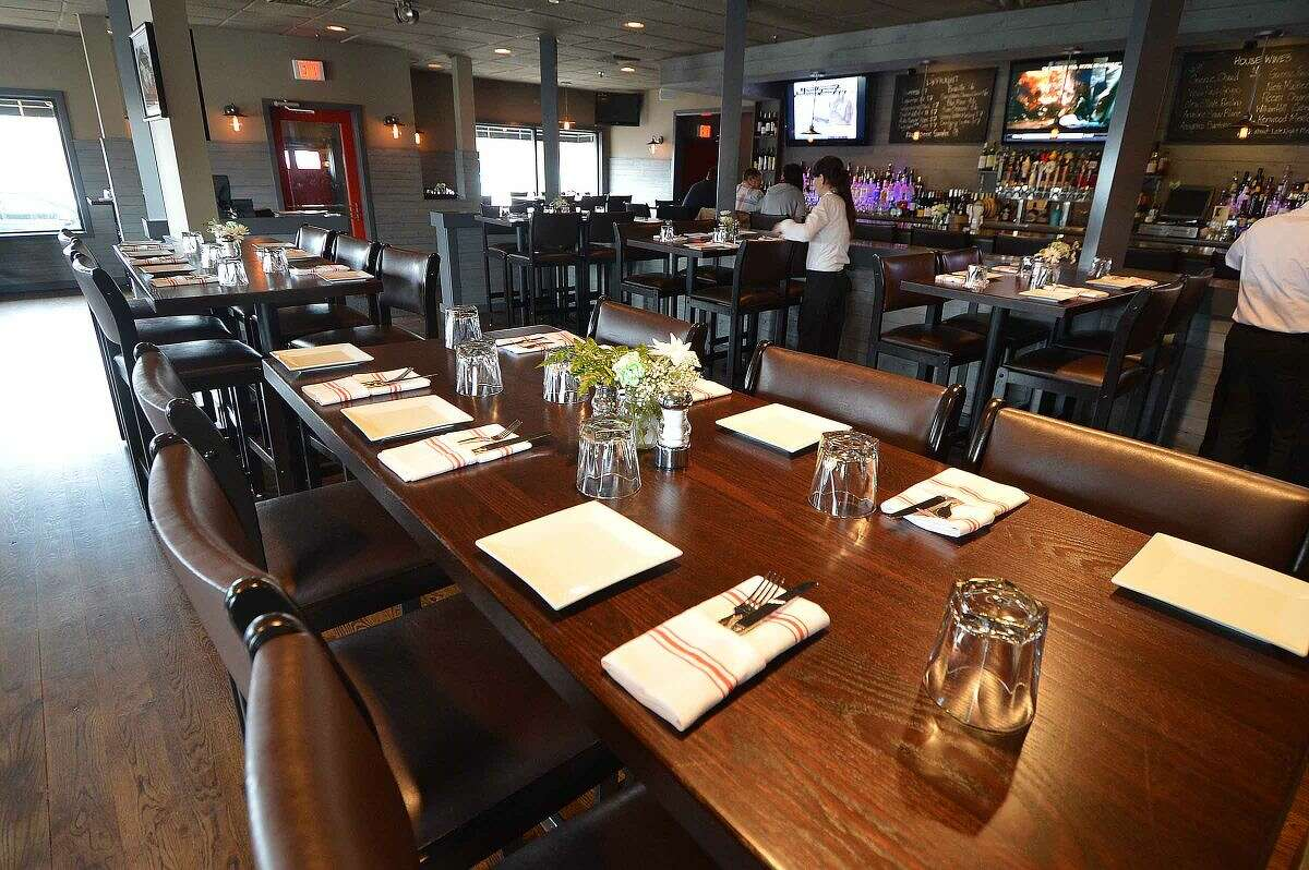 Hour Photo/Alex von Kleydorff The dinning room at The Station House Bar and Grille at 232 East Ave Norwalk