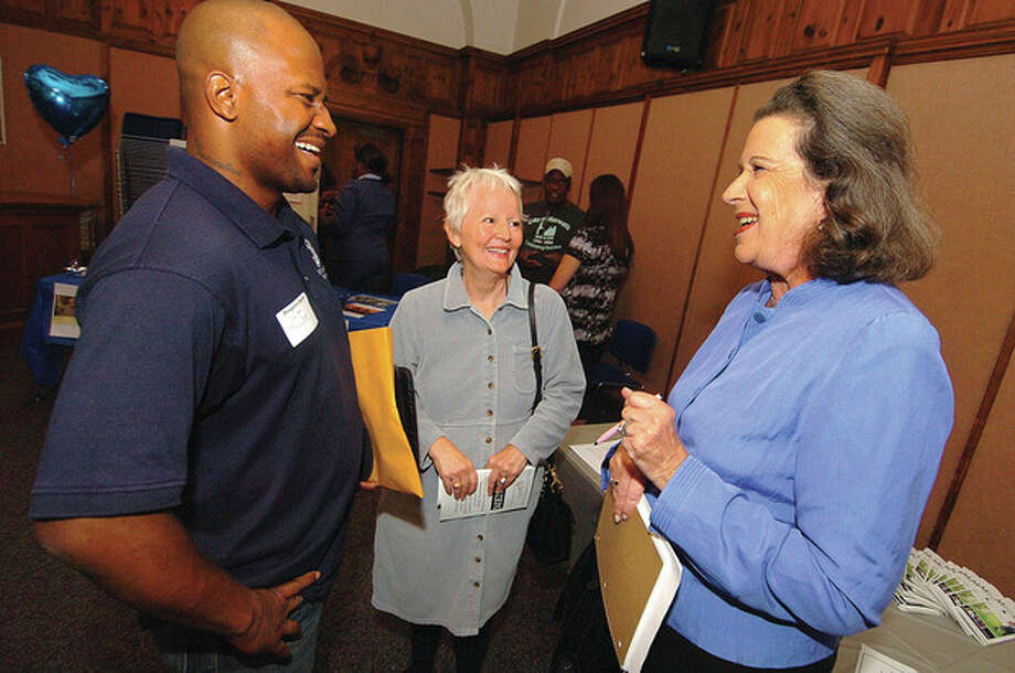 Hour photo/ Alex von Kleydorff From the left, Councilman Travis Simms talks with Eva Clements, assistant director of the Learning Center and Dr. Susan Weinberg, president of Mentor Consulting Group at the Norwalk Mentor Challenge at City Hall. / 2011 The Hour Newspapers/ Alex von Kleydorff