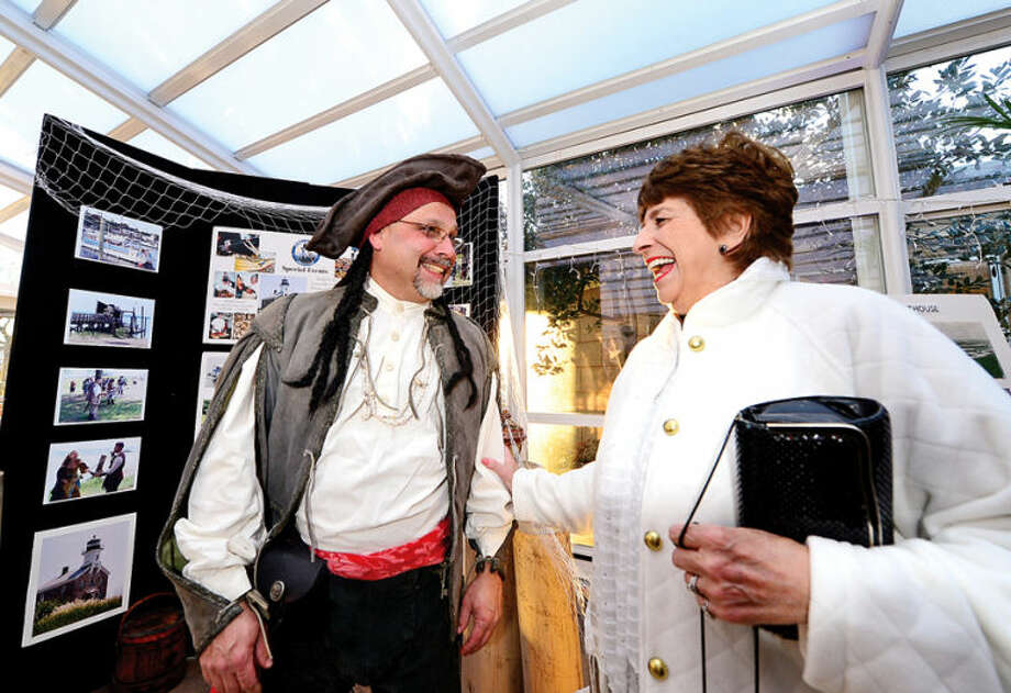 Hour photo / Erik Trautmann Norwalk Seaport Association (NSA) secretary Andy Garfunkel greets Carol Salvato during the 2014 NSA Pirate's Ball Gala at the Norwalk Inn Saturday.