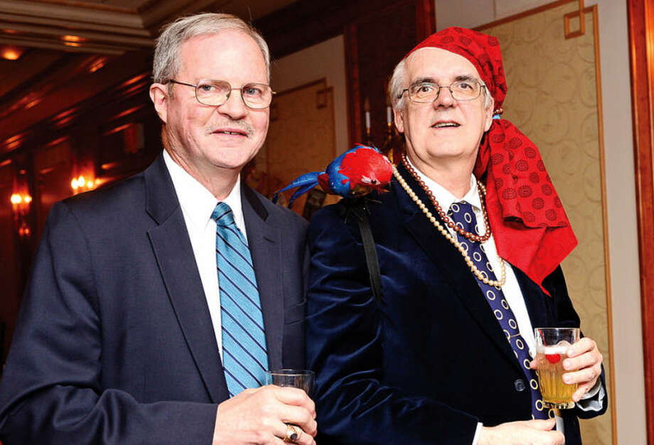 Hour photo / Erik Trautmann Norwalk residents David Van Buskirk and Roy Heget enjoy the 2014 Norwalk Seaport Association Pirate's Ball Gala at the Norwalk Inn Saturday.