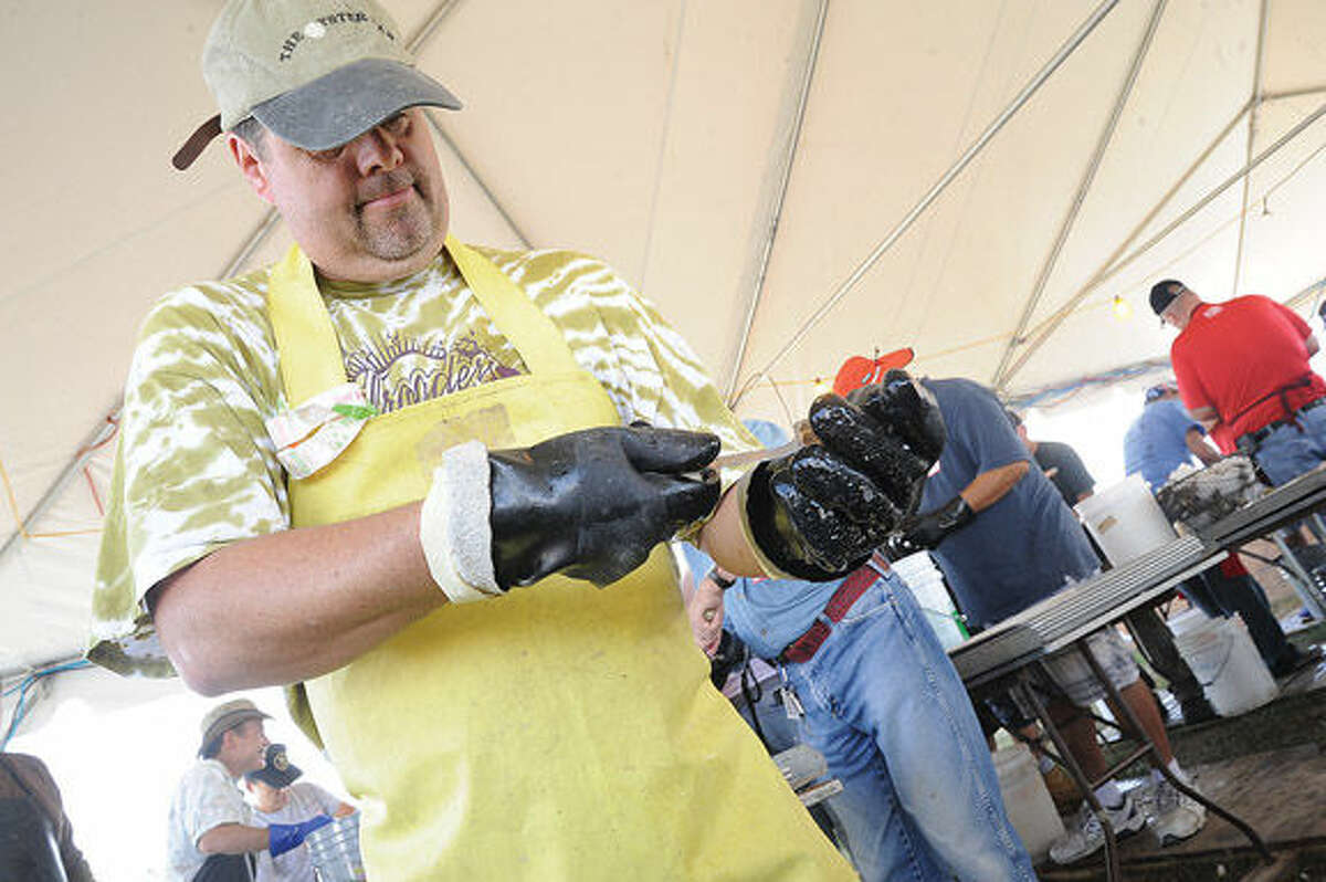 Norwalk native Chris Christman volunteers Sunday in the Flotilla 72 tent at the Oyster Festival. Hour photo/Matthew Vinci