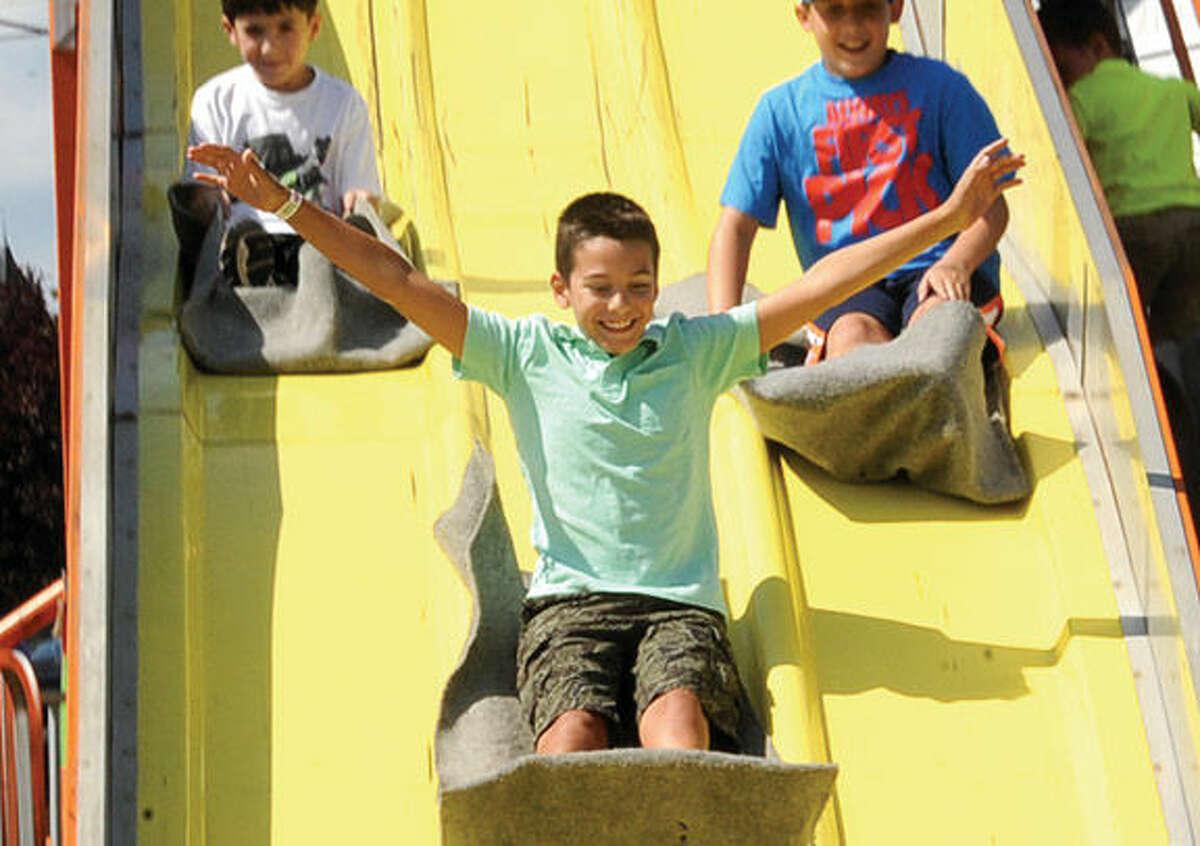 Lorenzo Zullo 11, on the Super Slide Sunday at the Oyster Festival. Hour photo/Matthew Vinci