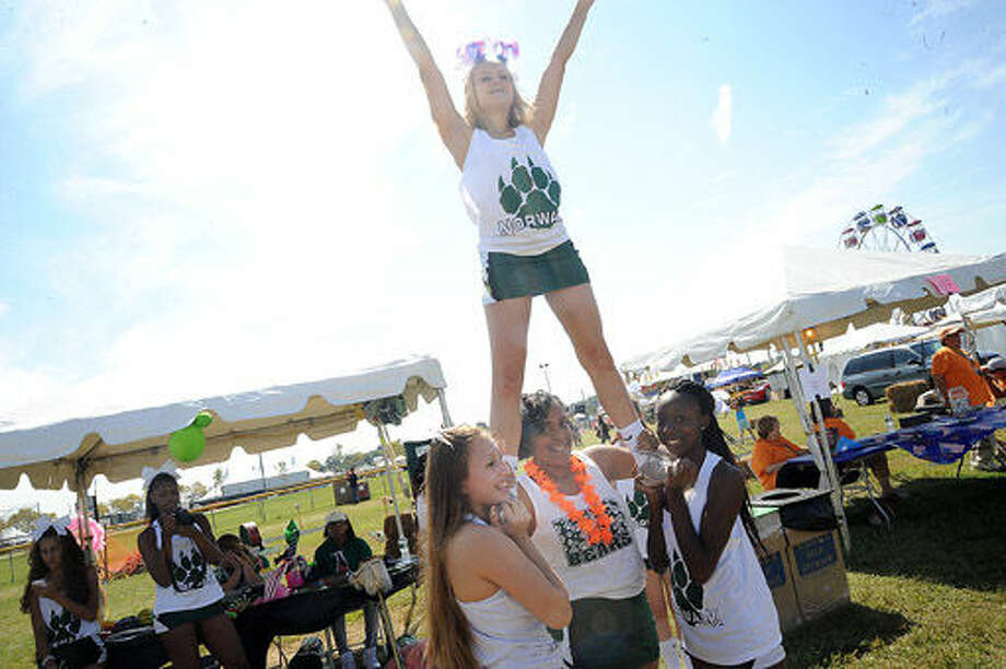 Norwalk High School cheerleaders Sunday at the Oyster Festival. Hour photo/Matthew Vinci