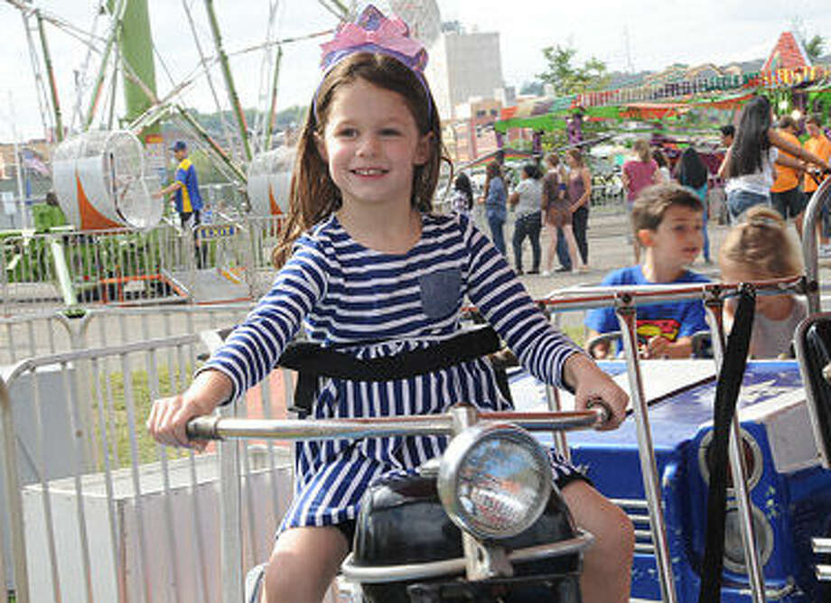 Four year old Caroline Far on a motorcycle ride Sunday at the Oyster Festival. Hour photo/Matthew Vinci