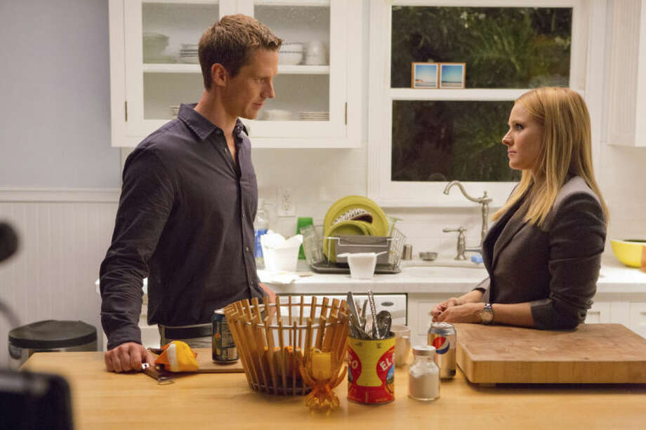"This image released by Warner Bros. Pictures shows Jason Dohring, left, and Kristen Bell in a scene from ""Veronica Mars."" (AP Photo/Warner Bros. Pictures, Robert Voets)"