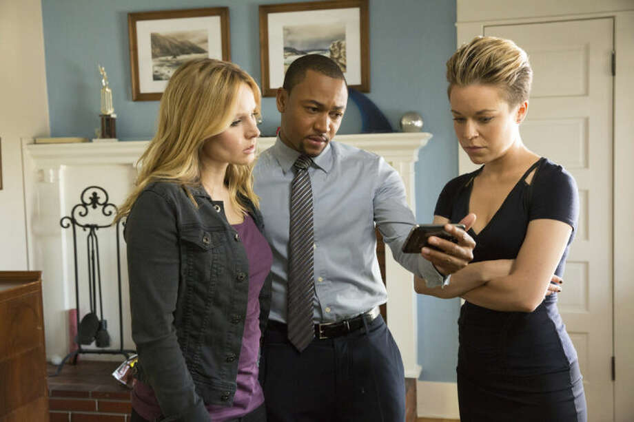 "This image released by Warner Bros. Pictures shows Kristen Bell, from left, Percy Daggs III and Tina Majorino in a scene from ""Veronica Mars."" (AP Photo/Warner Bros. Pictures, Robert Voets)"