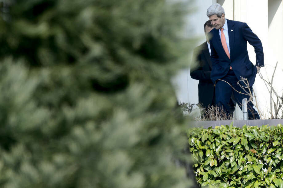U.S. Secretary of State John Kerry, walks outside the hotel during a break of a bilateral meeting with Iranian Foreign Minister Mohammad Javad Zarif for a new round of Nuclear Talks, in Lausanne, Switzerland, Thursday, March 19, 2015. (AP Photo/Keystone,Laurent Gillieron)