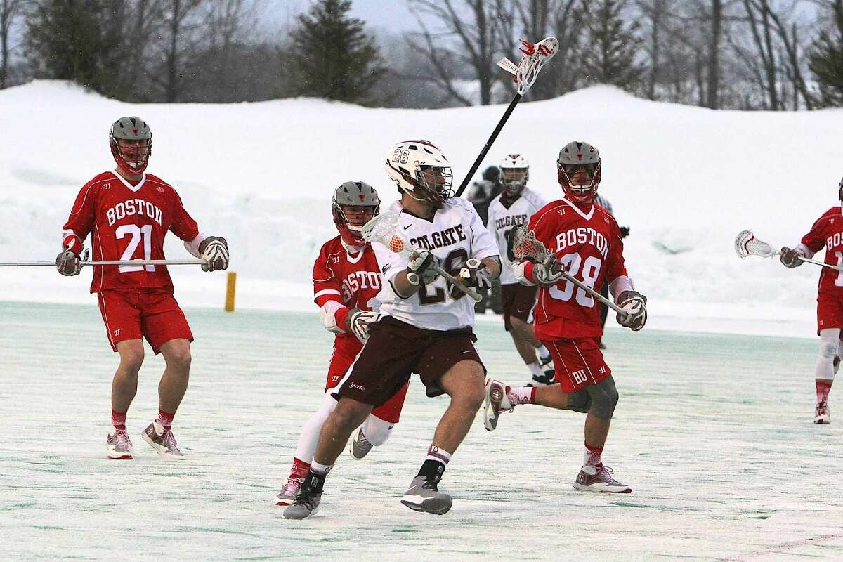 Matt Reyes-Guerra-Dunn, Wilton High School Class of 2011, looks to jump-start the offense in a recent Colgate lacrosse contest vs Boston University. Henry Lee, Wilton High School Class of 2013, scooped up several ground balls in helping BU to capture 82% of the face-offs and take the Patriot League Contest by a final score of 18 - 11.