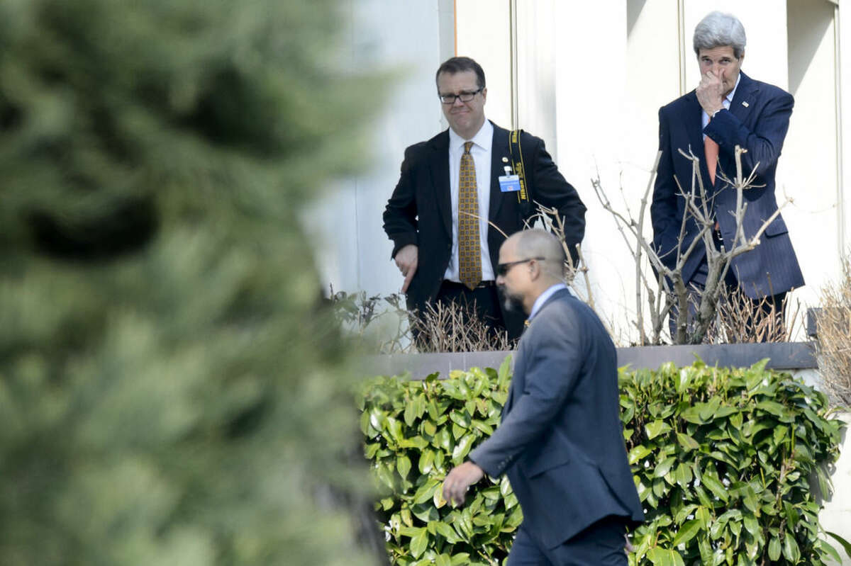 U.S. Secretary of State John Kerry, right, walks outside the hotel during a break of a bilateral meeting with Iranian Foreign Minister Mohammad Javad Zarif for a new round of Nuclear Talks, in Lausanne, Switzerland, Thursday, March 19, 2015. (AP Photo/Keystone,Laurent Gillieron)