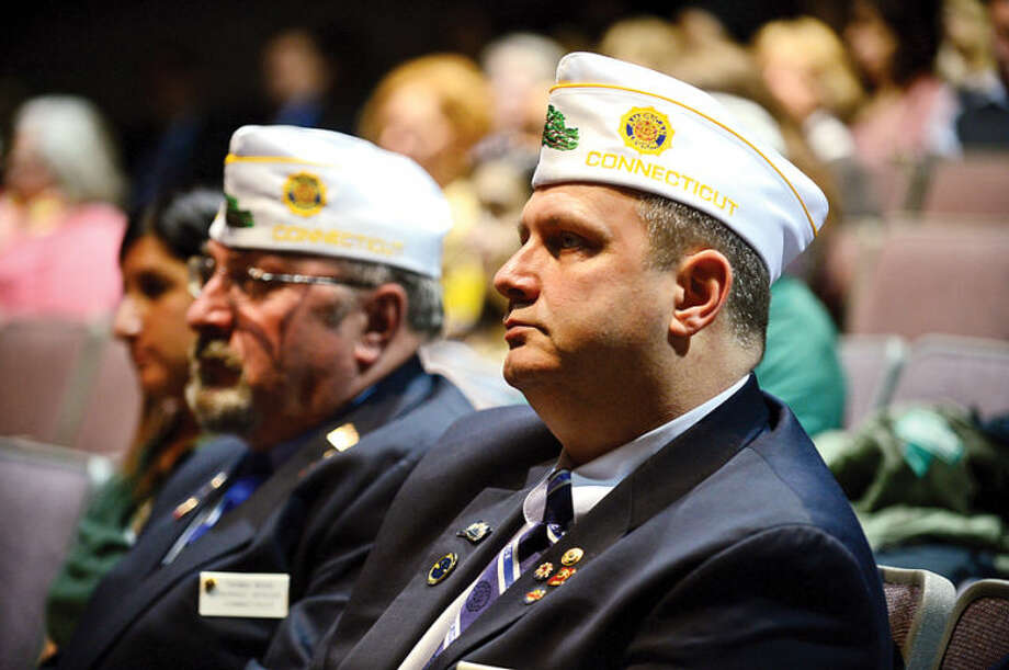 "Hour photo / Erik Trautmann Veterans including members of the Veterans of Foriegn Wars attend a program celebrating the partnership between Norwalk Community College and the Department of Veterans Affairs entitled ""Veterans' Education: Moving Forward at NCC"" Wednesday morning at the college."