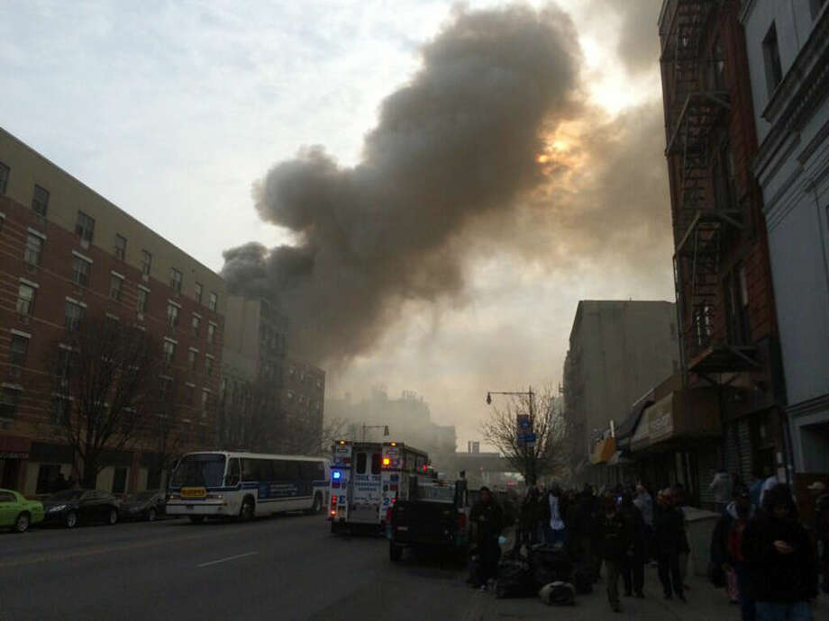 In this photo provided by Shane Kennedy, smoke rises from the site of an explosion and building collapse near Park Avenue and 116th Street in the East Harlem neighborhood of New York, Wednesday, March 12, 2014. (AP Photo/Shane Kennedy)